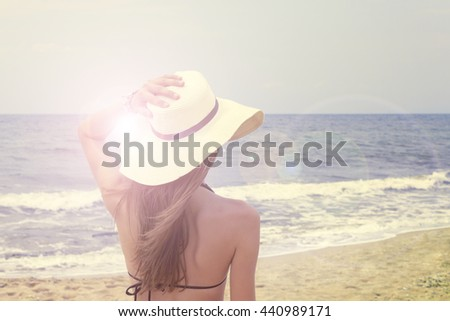 Young woman enjoying the ocean`s view in a summer vacation. - stock photo