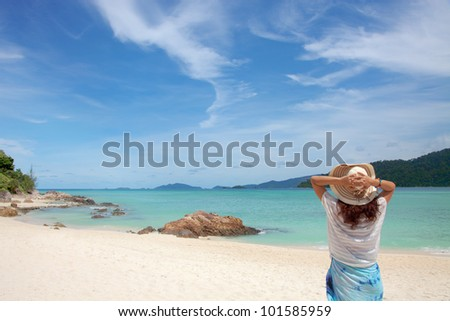 Young woman enjoying the sea view close to the sea - stock photo