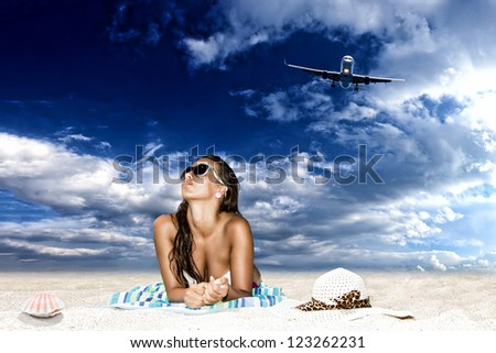Young woman enjoying the summer time on the beach - stock photo