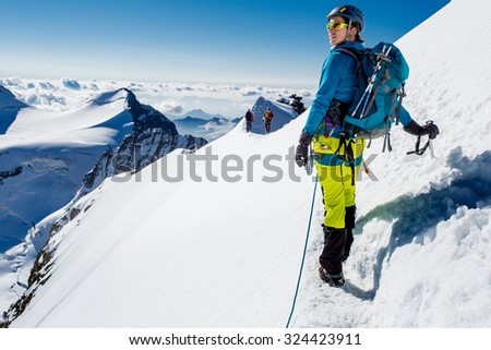 Young woman enjoying the view during mountain climb - stock photo