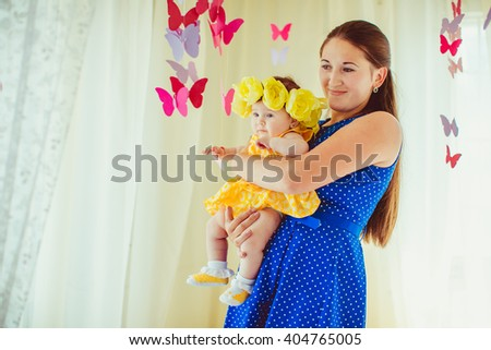 young woman enjoying time with her child