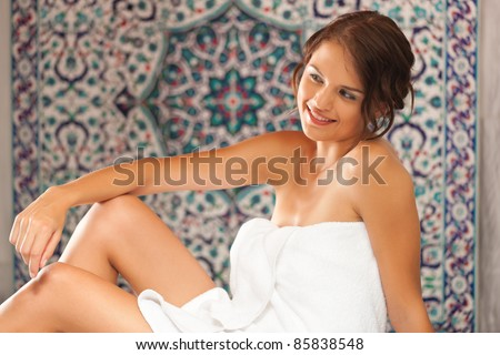 Young woman enjoys a steam bath in a thermal bath - stock photo