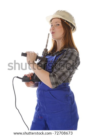 Young woman (Erin Crafts, DIY designer, trainee) with long hair wearing a plaid shirt and a blue work overalls. She is holding a large electric drill in his hand. Isolated against a white background.