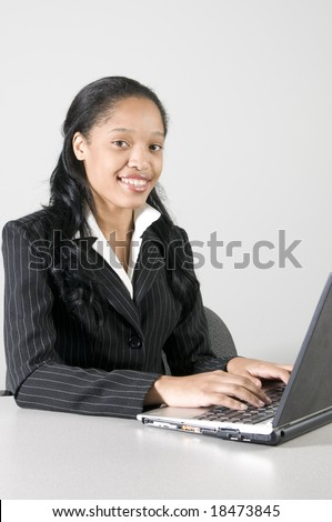 young woman executive working at her desk in office