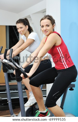 young woman exercise fitness and workout while run on track in sport club - stock photo