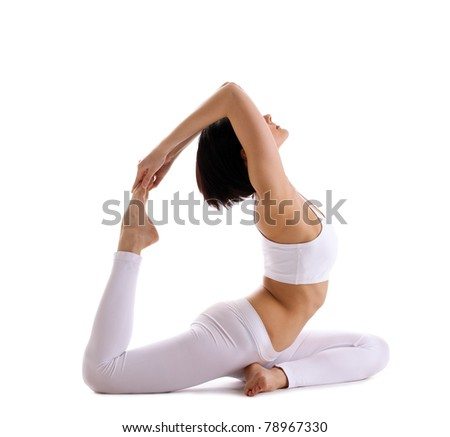 Young woman exercise yoga pose - pigeon isolated - stock photo