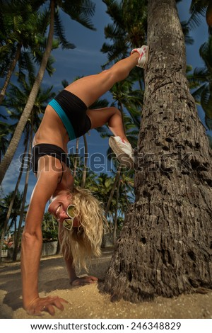 Young woman exercise yoga supported headstand - stock photo