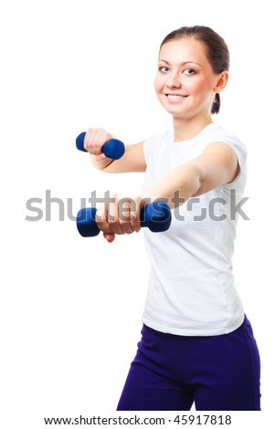 Young woman exercises with dumbbells isolated on white
