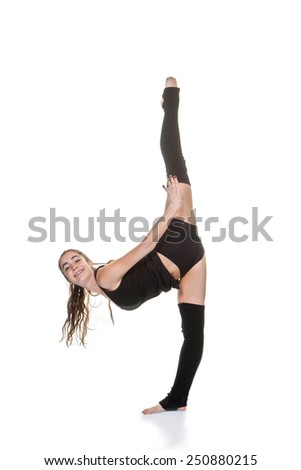 young woman exercising ballet or gymnastic stretches - stock photo