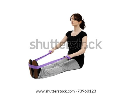 young woman exercising gymnastics with a purple ribbon