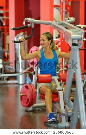 young woman exercising in the gym - stock photo