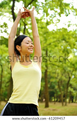 young woman exercising on the park - stock photo