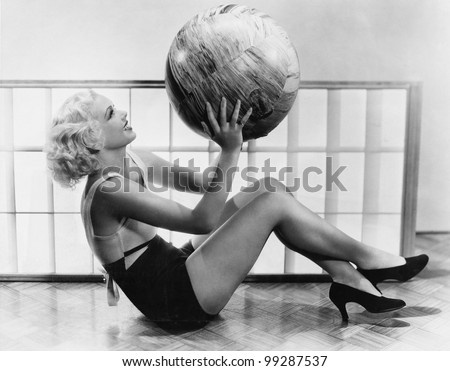 Young woman exercising with a big ball