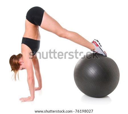 Young Woman Exercising with a Stability Ball - stock photo