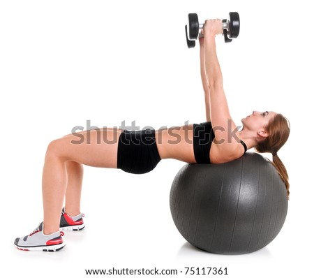 Young Woman Exercising with a Stability Ball and Dumbbells - stock photo