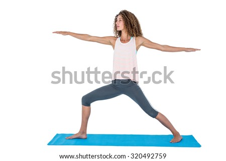 Young woman exercising with arms outstretched against white background