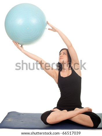 young woman exercising with big blue ball