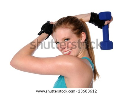 Young woman exercising with dumbbell isolated over a white background - stock photo