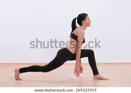 Young woman exercising yoga - stock photo