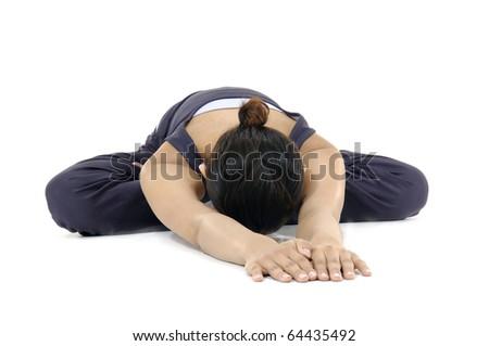 Young woman exercising yoga - stock photo