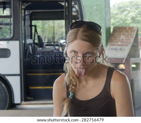 Young woman exhausted after bus tour - Santa Cruz, Costa Rica - stock photo