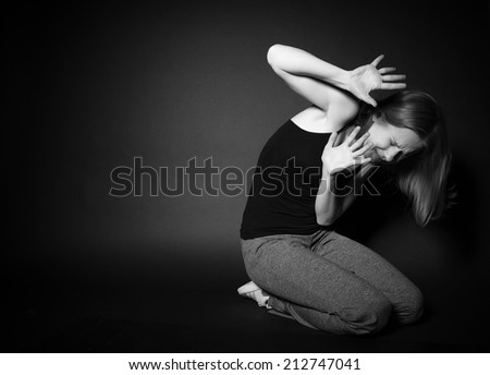 Young woman experiences depression, fear, despair, loneliness - stock photo