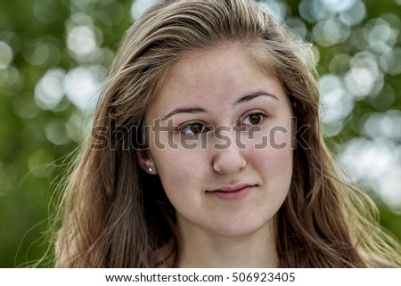 Young Woman expressing contemplation with a smile
