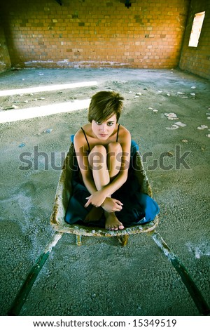 Young woman expressing vulnerability in the middle of nowhere - stock photo