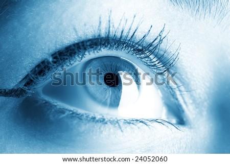 Young woman eye closeup. Soft blue tint. - stock photo