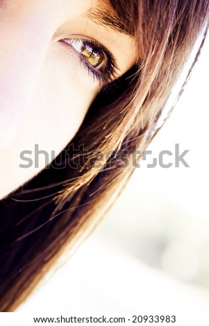 Young woman eye looking at something - stock photo