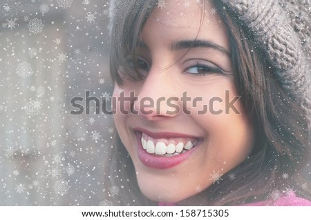 young woman face and snow flakes