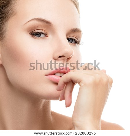 Young woman face with perfect skin studio portrait isolated on white background - stock photo