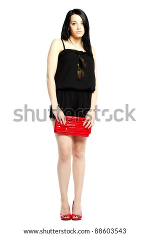 Young woman fashion model calm in heals wearing one piece jumpsuit - stock photo