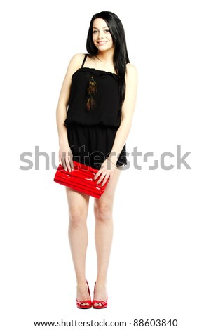 Young woman fashion model calm in heals wearing one piece jumpsuit smiling - stock photo