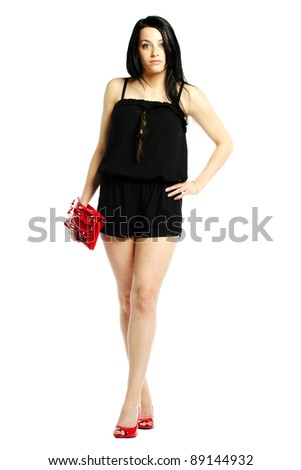 Young woman fashion model in heals wearing one piece jumpsuit - stock photo