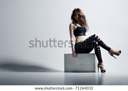 Young woman fashion. On wall background. - stock photo