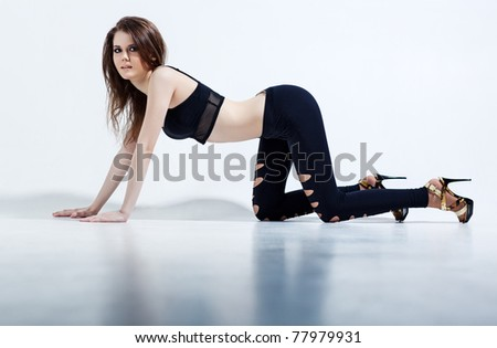 Young woman fashion. On white wall background. - stock photo