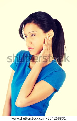 Young woman feeling a pain in ear,isolated on white background