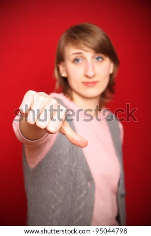 young woman feeling dissatisfied tending towards a negative reaction (focus on hand) - stock photo