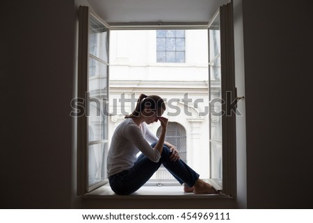 Young woman feeling sad and lonely.  - stock photo