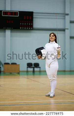 Young woman fencer with epee  - stock photo