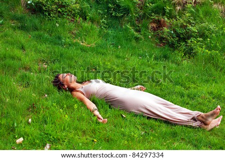 Young woman finds peace and pleasure in nature - stock photo