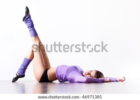 Young woman fitness exercises. Bright white interior. - stock photo