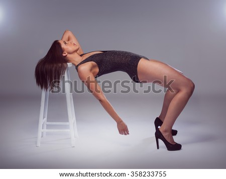 Young woman fitness. in heels and body - stock photo
