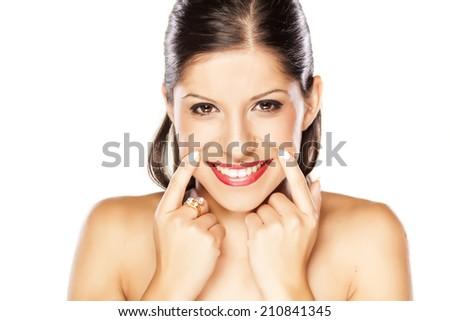 young woman forcing her smile with her fingers