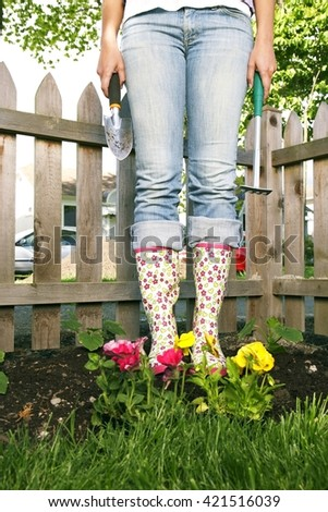 Young woman gardening - stock photo