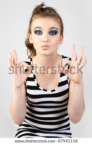 Young woman gesturing. - stock photo