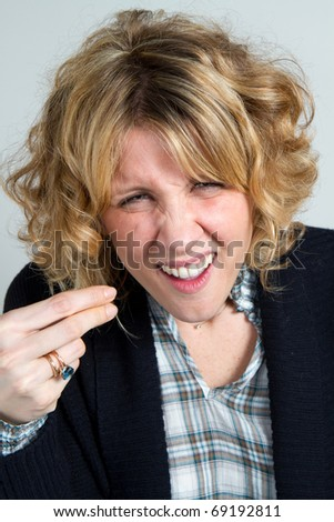 young woman gesturing do not know sign - stock photo