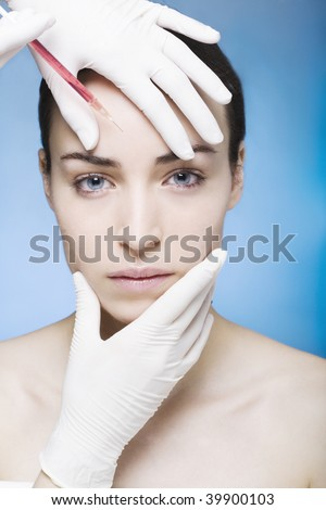 young woman gets a injection - stock photo