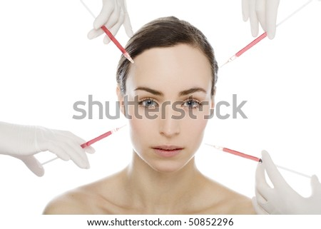young woman gets an injection from many syringes - stock photo